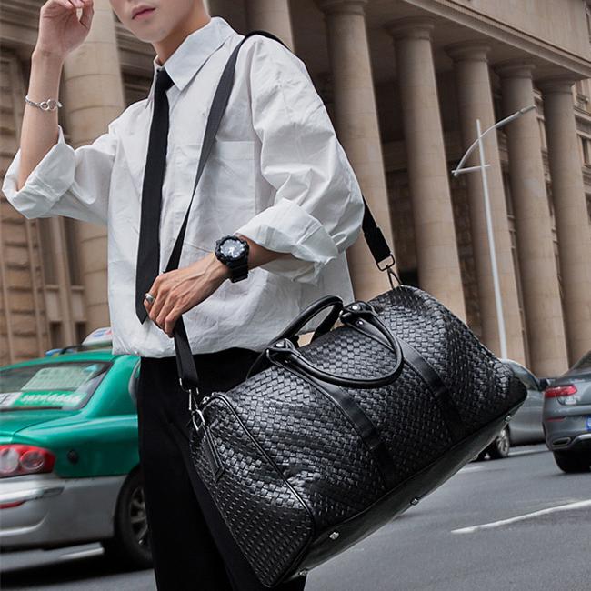 时尚潮流手提旅行包男 大容量编织皮行李袋 休闲出差健身包 短途旅游包潮
