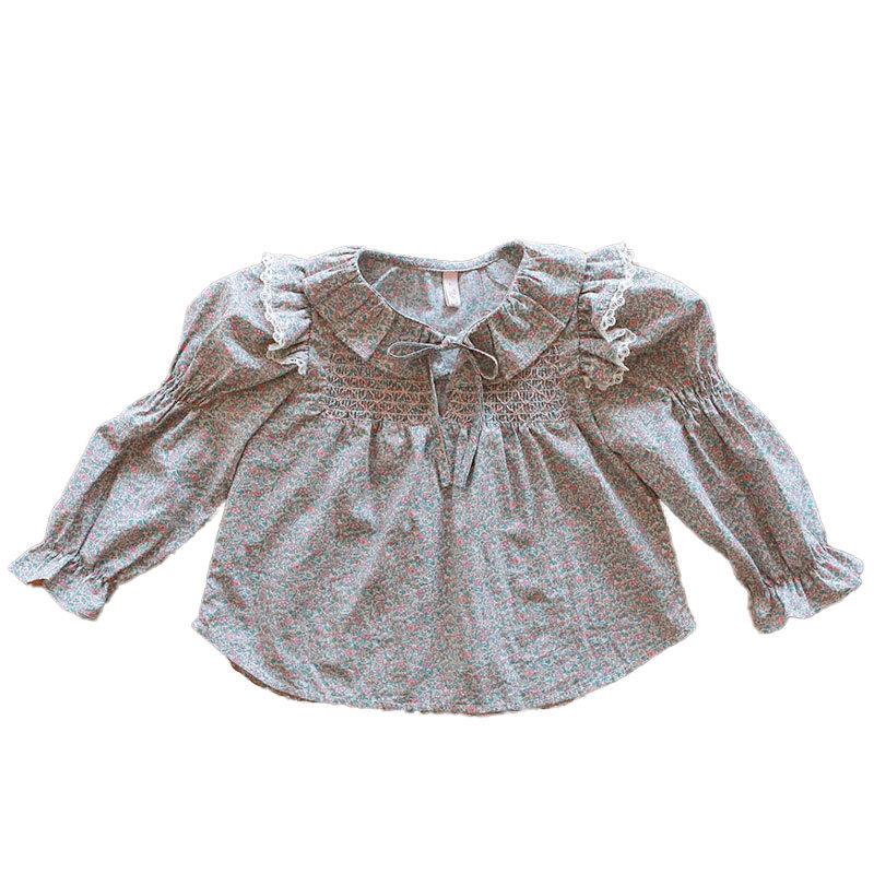The small lapel smocked shirt